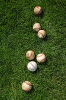 Baseballs on grass