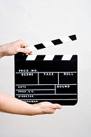 A man holding a movie clapperboard