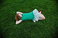 A young woman lying on grass