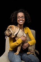 A young woman with her Shar_Pei, studio shot