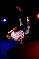 A B_boy doing a Pike Freeze breakdance move