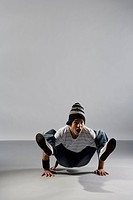 A B_boy doing a Crab breakdance move