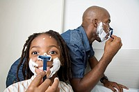 A son imitating his father shaving