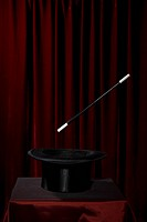 A magic wand hovering over a top hat
