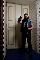 A bouncer in front of a door