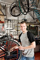 A man repairing a bike in a workshop