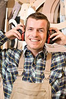 A carpenter with ear protectors