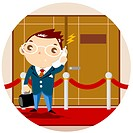 Portrait of businessman using mobile phone while standing on red carpet