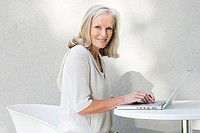Middle aged woman using laptop (thumbnail)