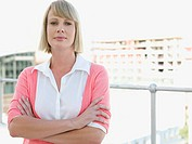 Businesswoman standing on balcony