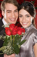 Romantic couple holding a bunch of roses