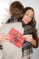 Woman holding a gift and hugging