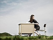 Woman in field with desk
