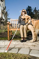 Blind woman with a guide dog