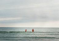 Two women bathing in the sea Sweden.