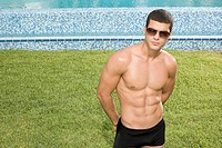 Man in sunglasses and swimming trunks