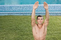 Man stretching by swimming pool (thumbnail)