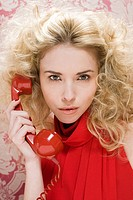 Young woman with telephone handset