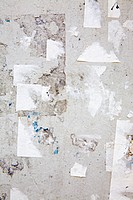 Torn paper on a wall