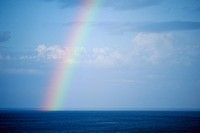 Single rainbow over sea