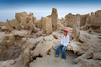 Siwa Town, Siwa Oasis, Egypt, Africa, Tourist enjoys mud brick fortress of Shali
