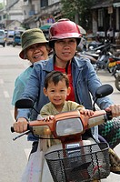 Three generations on a bike, Luang Prabang, Laos