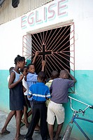 Haiti, Young children looking through window into church