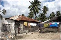 Pwani Mchangani,Zanzibar,Africa,Village scene,huts and washing on the line