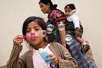 Patzicia,Guatemala,Girl blowing bubbles with a bubble wand
