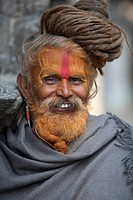 Man outdoors with face paint in Nepal