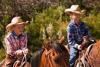 Two boys on horses