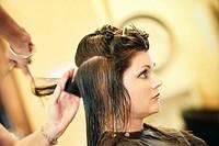 Woman having her hair cut