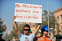 Santiago Chile May 01 2009 thousands of people demonstrate in the global day of the worker shouting slogans against the government of President Michel...