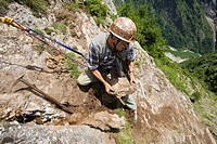 Rockhounder at work, Baldschieder Valley, Bernese Alps, Canton of Valais, Switzerland