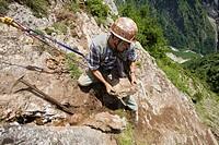 Rockhounder at work, Baldschieder Valley, Bernese Alps, Canton of Valais, Switzerland