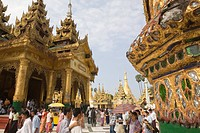 People in front of the Prayer hall in the Shwedagon Pagoda at Yangon, Rangoon, Myanmar, Burma