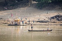 Children playing at the bank of Ayeyarwady river between Mandalay and Bagan in Myanmar, Burma