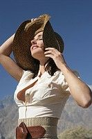 Young woman in hat relaxing in the sun.