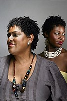 Portrait of two mid adult African American women, studio shot