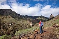 Hiker in the mountains looking at the view, Roque de Agando, La Gomera, Canary Islands, Spain, Europe