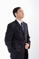 Businessman looking up with hand in front, Business People