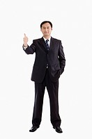 Businessman standing with thumbs up, Business People