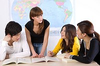 Four college students having a discussion together, Studying, Education