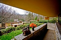 The view from the Fallingwater guest house shows the progressive canopy over the asccess stairs. Structure in background is the main house penthouse. ...