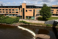 river strule and south west college of further and higher education campus at omagh county tyrone northern ireland uk