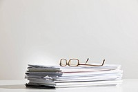 Eyeglasses on paperwork