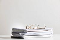 Eyeglasses on paperwork