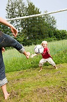 Mother And Son Playing Soccer
