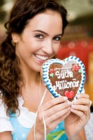 Young Woman With Gingerbread Heart