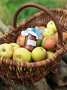 Apples in basket with jar of apples